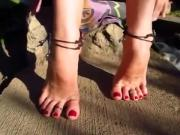 Girl Shows Off Her Sexy Bare Feet With Red Painted Toe Nails In The Great Outdoors