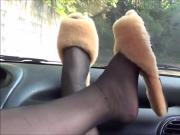 Dangling slippers on dashboard of car