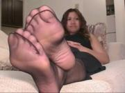 Wiggling French manicured toes through nylons