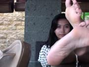 Young Asian Girl Teases with Beautiful Barefooted Bliss