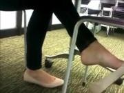 Texting and dangling shoes in college classroom