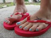 Trying on different pairs of Soda flip flops