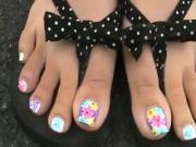Pretty toes in black bows
