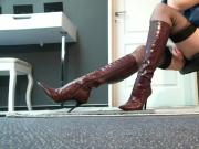 Hottie in sexy brown boots and stockings touching herself at the office