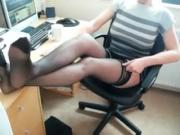Sexy feet in stocking on desk