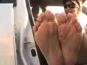 Flip Flops taken off and feet hanging out of car