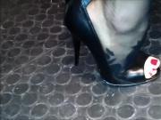 Peeptoe stilettos on metallic floor
