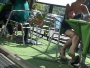 Dangling pumps while smoking at table