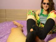 Girl in sunglasses gives footjob in black socks