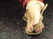 Open sandals on public train