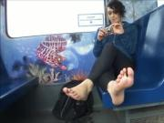 Brunette foot exhibitionist on train