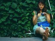 Adorable Brunette Hippy Gal Sits In Shrubs and Shows Off Her Dirty Feet While Smoking
