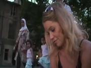 Blonde walking in the street and get dirty feet
