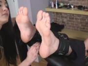 Tied up foot tickling torture on bandage device