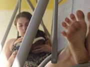 Dirty feet outside on swing couch
