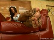 Bambi spreading her toes through black fishnet stockings