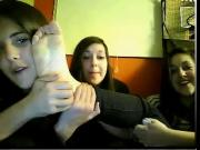 Four young women show feet on webcam