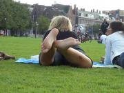 Two Hot Young Unsuspecting Ladies Get Their Cute Bare Feet Filmed On The Grass