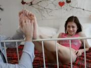 Young European mynx gets tickled on her bed