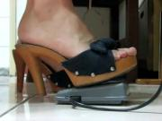Sexy feet in bow toe platforms pumping sewing machine
