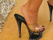 German woman in unique high heeled studded stiletto sandals