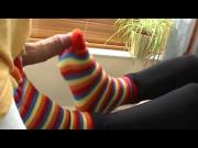 Amateur hottie loves wearing sexy socks while giving a footjob