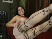 Busty brunette babe exposes her sexy feet in nylon stockings