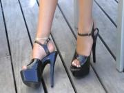 Patent leather open toed ankle straps on deck