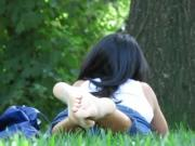 Unsuspecting Girl Lies Down In The Grass And Gets Her Soft Little Feet Filmed