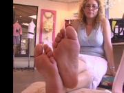 Mature feet closeup in store