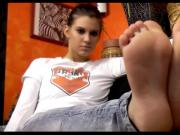 Foot tease in tight blue jeans