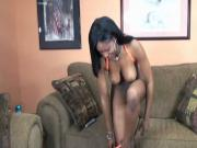 Juggy black damsel shoves a vibrator up her sweet black pussy on the couch