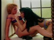 Sexy brunette lesbo in boots gets her cunt stuffed with dildo by hot blond
