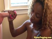 Tattooed ebony tugging cock and looking bored