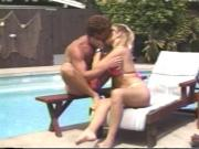 Long haired blond takes cock down her throat poolside