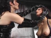 Sex slave gets her tits pinched by a mistress
