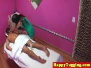 Petite asian tugging masseuse giving handjob