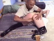 Chick with nice tits in black latex lets a big black cock into her slit on bed