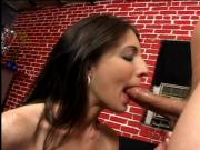 Long haired dude gets his hard cock blown by brunette beauty