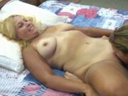 Brunette MILF sticks her tongue in horny blondes pussy