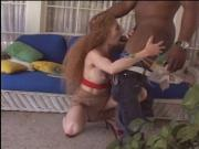 Fiery redhead gets her ginger pussy fucked by a black stud until she squirts