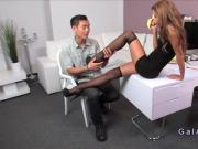 Female agent in stockings gives footjob