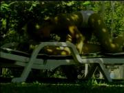 Horny blonde lesbians make love on a sunbathing chair