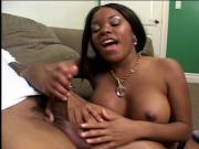Cute black chick with perky tits gives fierce hand job on couch