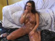 Curly mature brunette loves chocolate blowjob