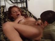 Redhead slut rides a midget's hard cock on bed