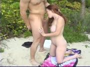 Yuong female gets cunt sucked on beach by cute white male