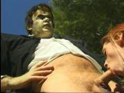 Guy in Frankenstein costume gets his cock sucked by horny schoolgirl