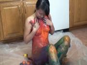 Classic brunette asian slathers paint all over her slim body