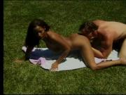 Hot brunette gets fucked while lying in the grass
